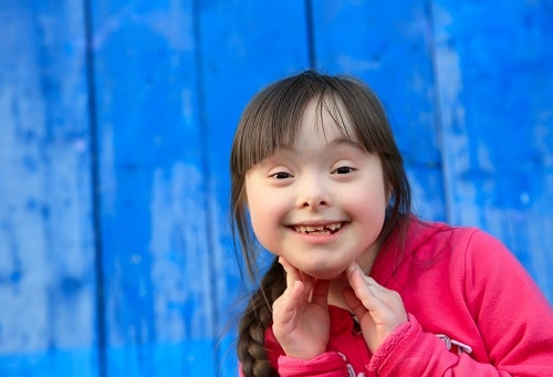 smiling girl with special needs