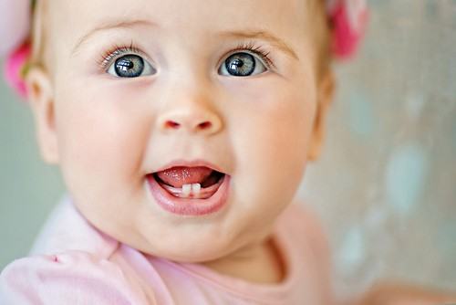 smiling baby with teeth