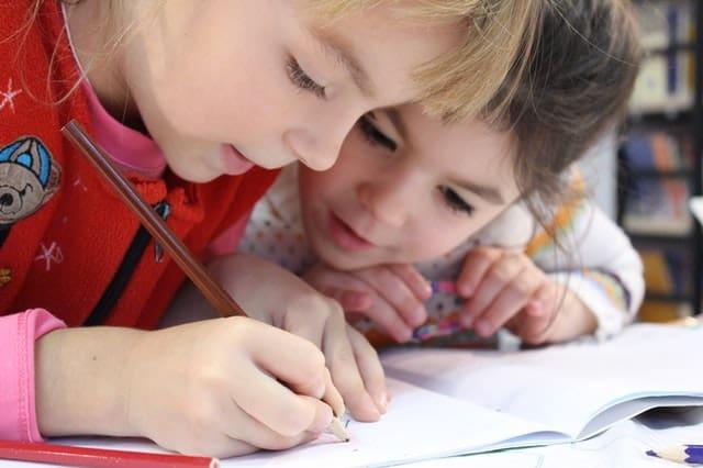 young kids doing homework